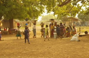 Women and children at the Kukuo camp for alleged witches prepare for market day.